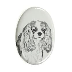 Lastra di ceramica ovale tombale con immagine del cane.