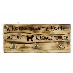Wooden wall hanger with the picture of a dog and the words